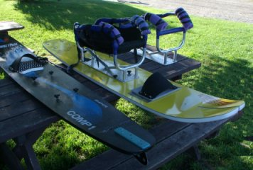 [ Some of the adaptive equipment, sit-skis and cages, used in our program. ]